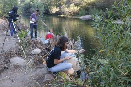 Students at river surveying
